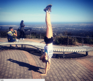 A celebratory handstand after conquering Mount Lofty!